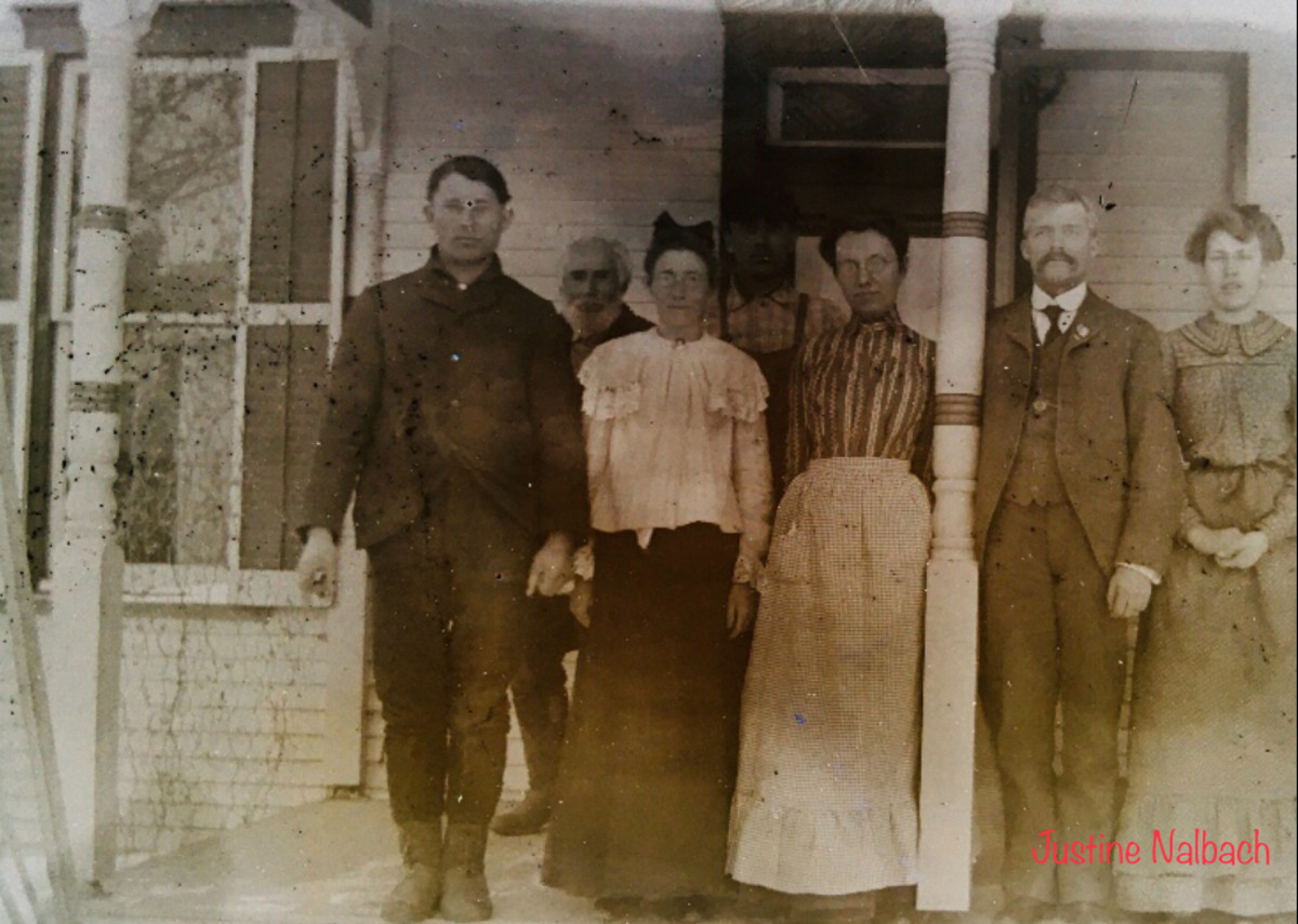 The Vollmar Men and their Wives, with Old Man Vollmar in the back.