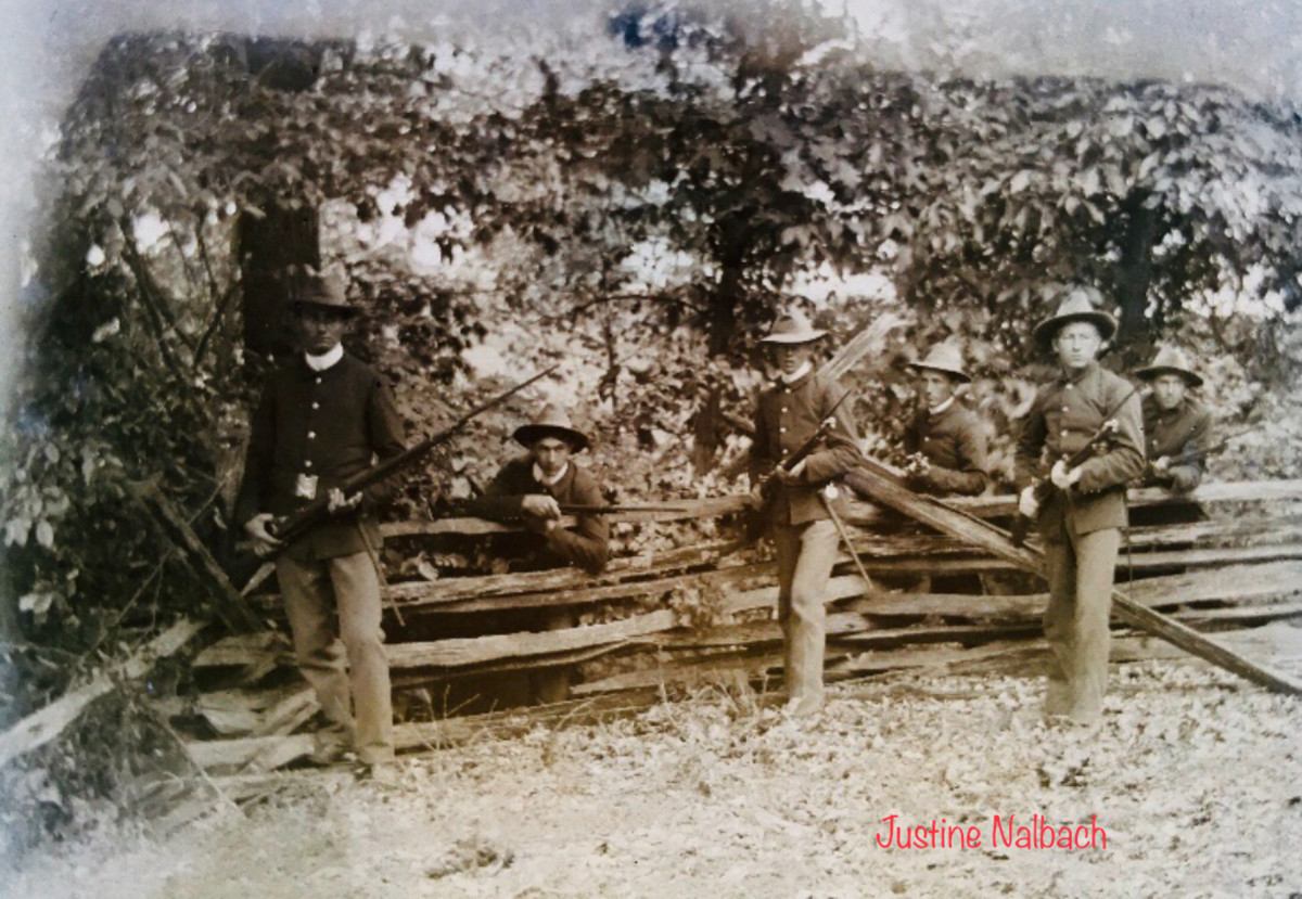 What looks to be Soldiers from the Spanish American War, holding bayonets while posing for the photo. April of 1898 makes it probable for young William to be the one who fought in this war.