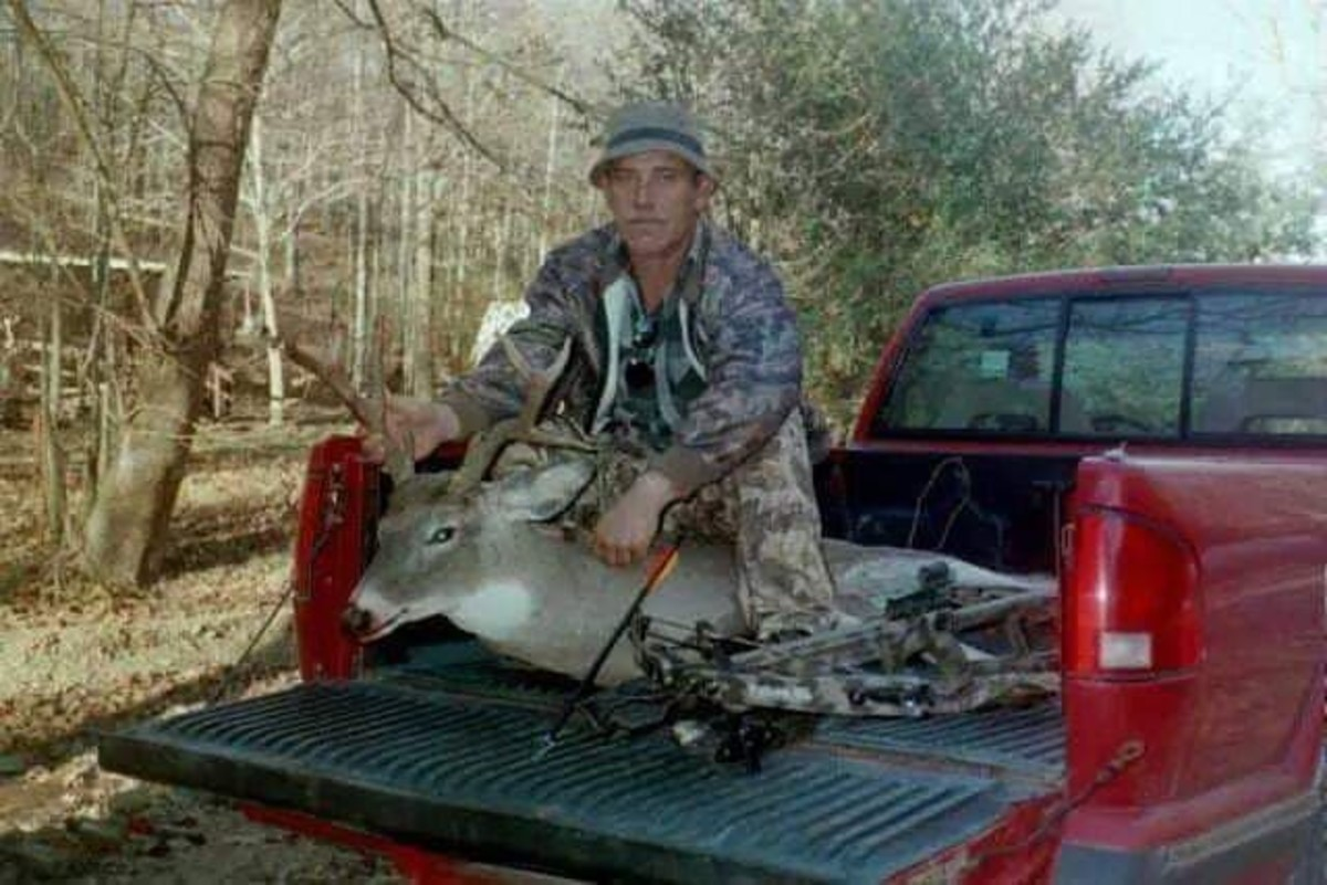 Dad and the non-typical buck he snagged with a bow.