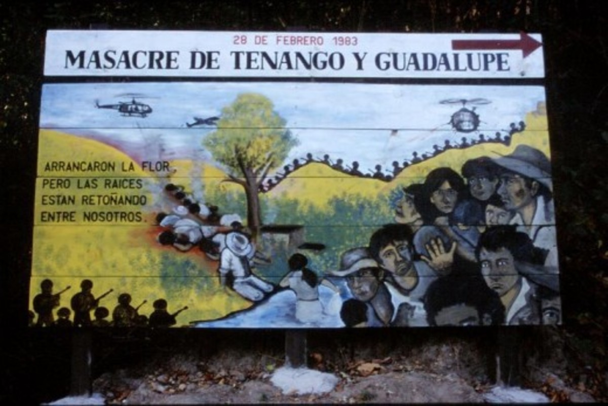 """A billboard serving as a reminder of one of many massacres that occurred during the Civil War in El Salvador. The Spanish inscription to the left reads in English: 'They tore out the flower, however the roots are sprouting among us.'"