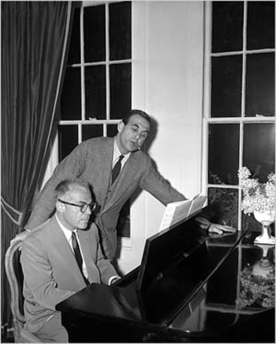 Cy Feuer (sitting) and Ernest Martin