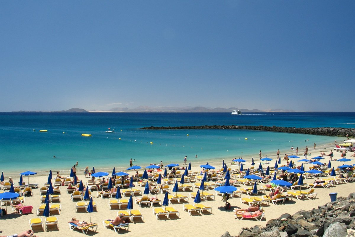 Views across Atlantic Ocean to Island of Fuerteventura from Dorado beach in Playa Blanca.