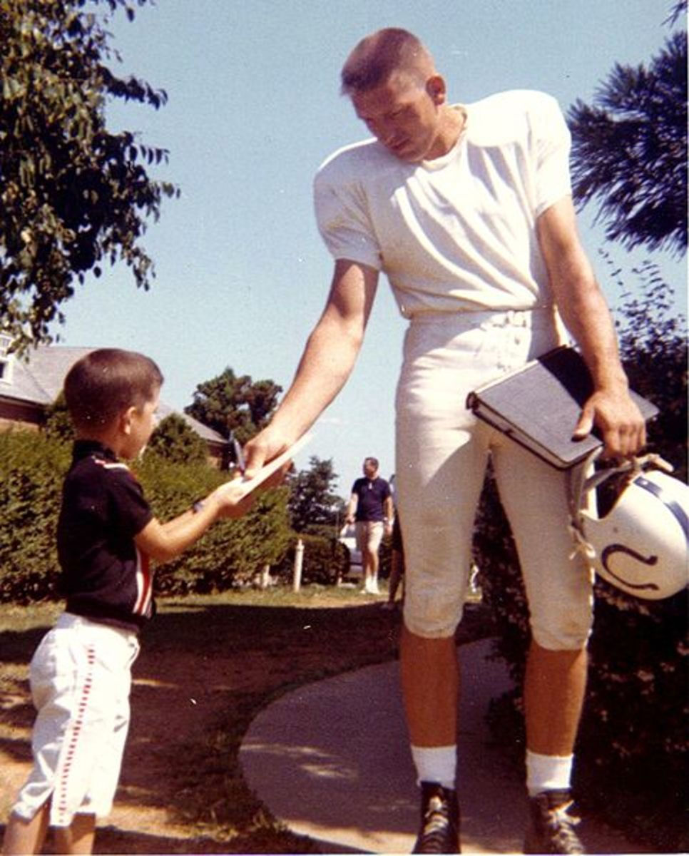 Johnny Unitas Baltimore Colts quarterback signs autograph at West Minster training camp.