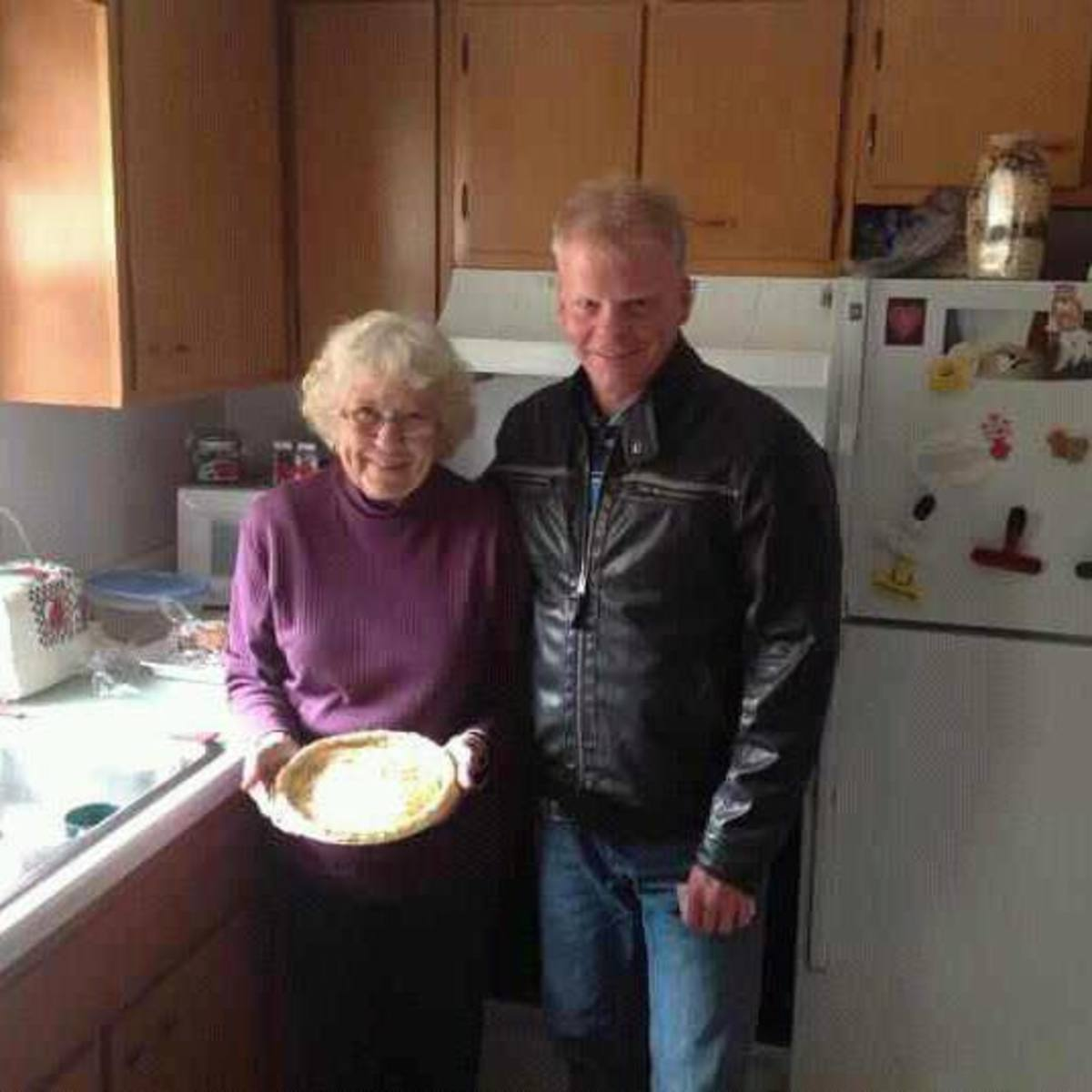 Mom, still baking pies at 85 with my brother, Kerry who had better save some pie for me.