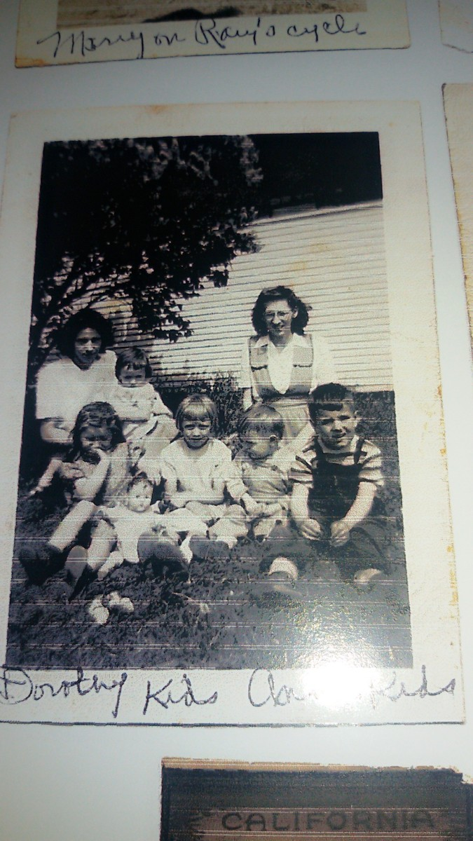 A four year old boy enjoying a trip to grandma's house in Marshfield.  From left to right: back, mom holding my sister Beatrice and aunt Sissy. Sitting in front are cousin Carol, aunt Mary, cousin Jerry, and the author. Taken around 1948.