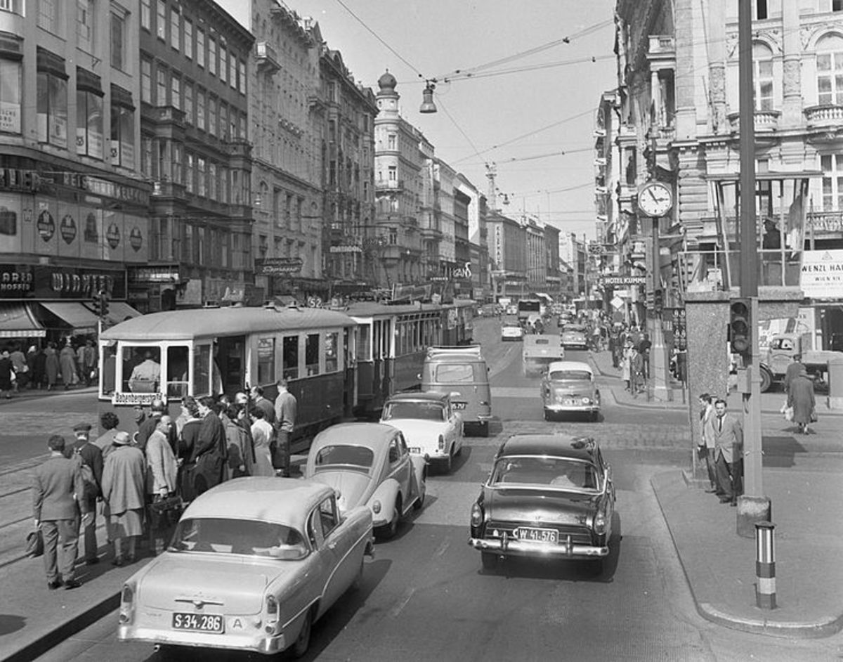 Mid-Sixties Mariahilferstrasse, home to huge (by most standards at the time) department stores Herzmansky and Gerngross. I sold newspapers on the street corner outside Gerngross' store,  received an early form of 'toastie' sandwich from demonstrators