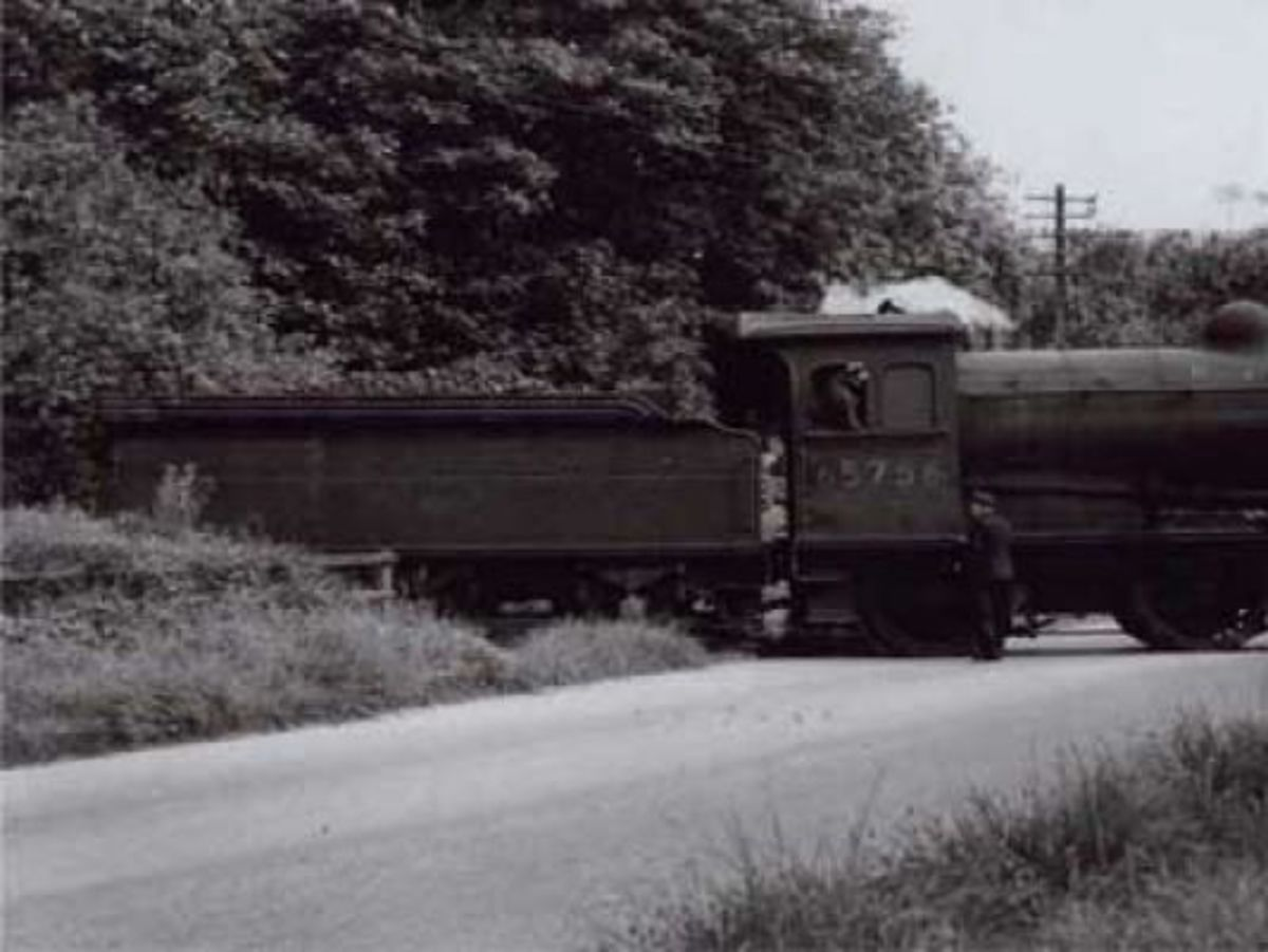 J26 0-6-0 crosses Flatts Lane to the brickworks. The Cleveland Railway built a branch from Middlesbrough via Flatts Lane crossing to ironstone mines on Barnaby Side & Upsall Moor above Eston. It was cut back by late 19th Century to the brickworks
