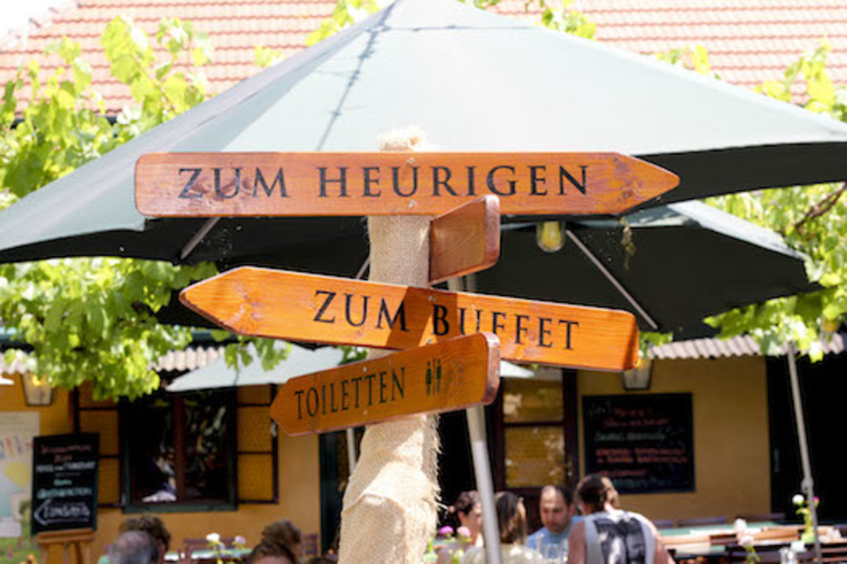 Vienna isn't Vienna without 'Heurigen'. Locals quaff locally harvested wines - red or white (and the new wine, like drinking paint remover!) The signpost points to the winery, the buffet - not forgetting the toilets. Get to know the Viennese here