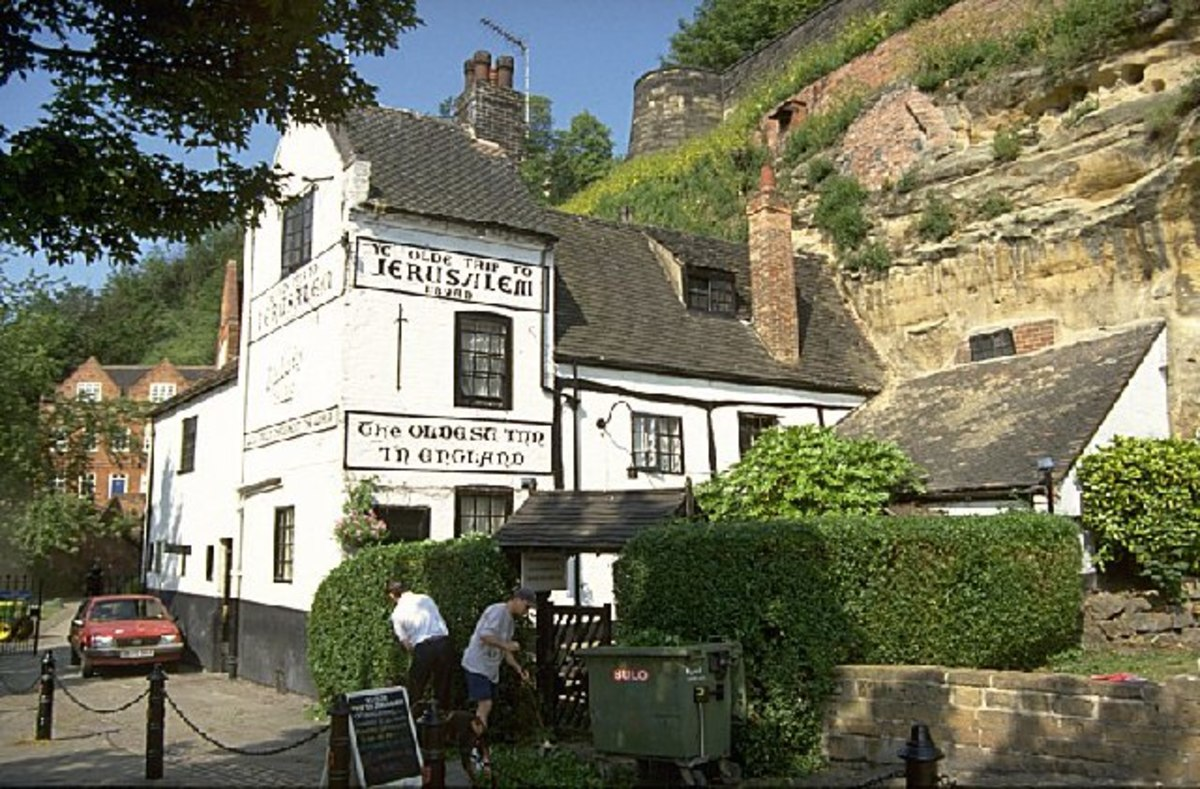 England's oldest pub, Ye Old Trip To Jerusalem below the castle walls. You could stand with your back to the cliff wall and look up the chimney to the blue sky above. This was built at the time there was only a 'burh' called 'Snotingaham' (see text)