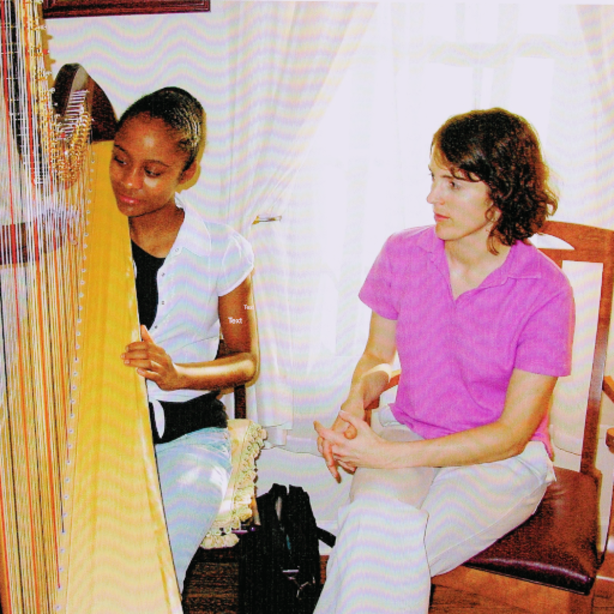 Angelica taking a lesson with ASO Principal Harpist Elisabeth Remy Johnson
