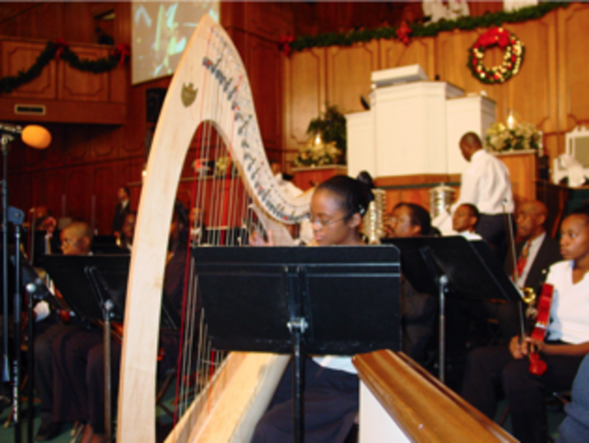 Angelica performing on the lever harp with the Greenforest Church Orchestra.