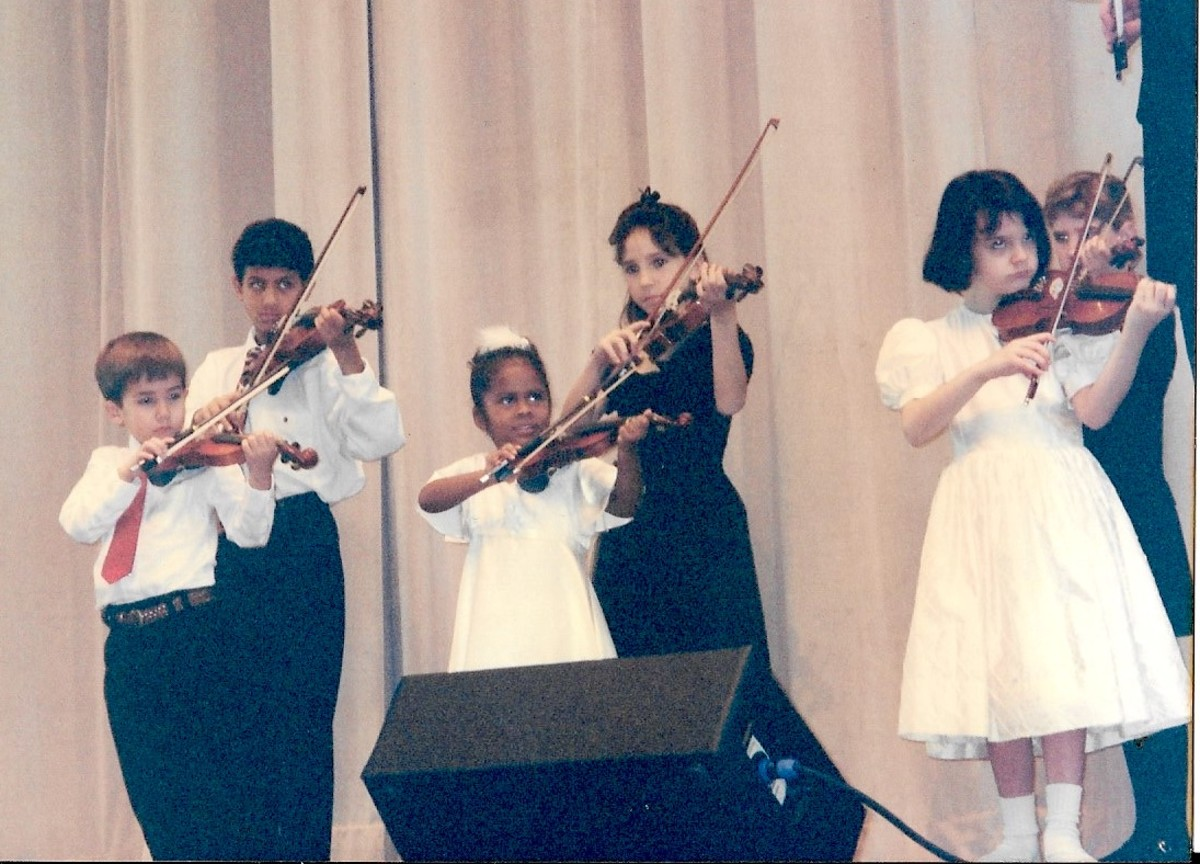 Angelica performing with her Suzuki Violin Class