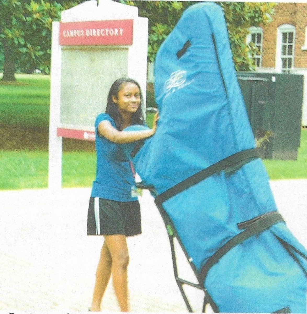 Angelica carting her harp at the Eastern Music Festival in Greensboro, N.C.