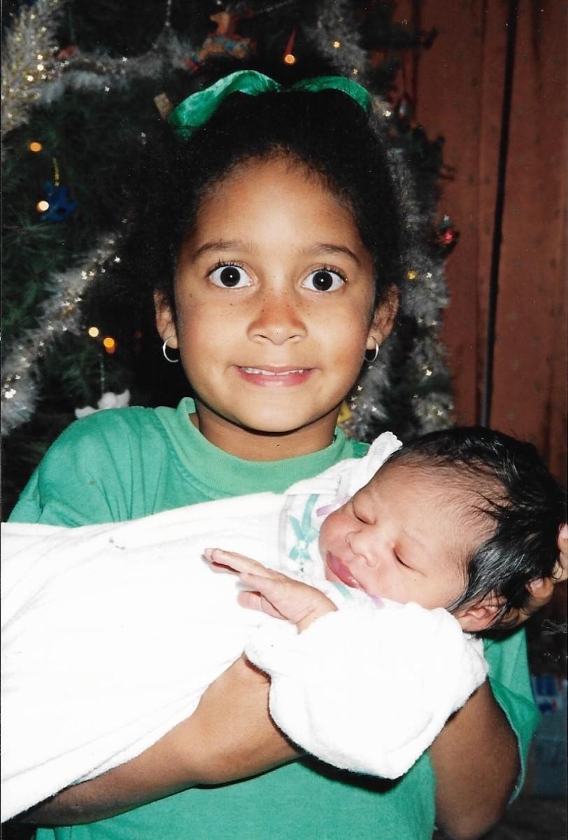 Maya coddles the family's Christmas miracle.