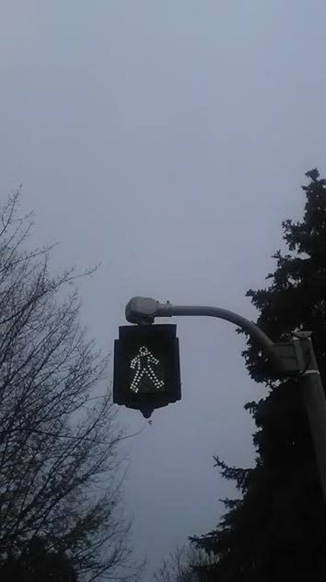 A cross walk sign in the province of Ontario, Canada