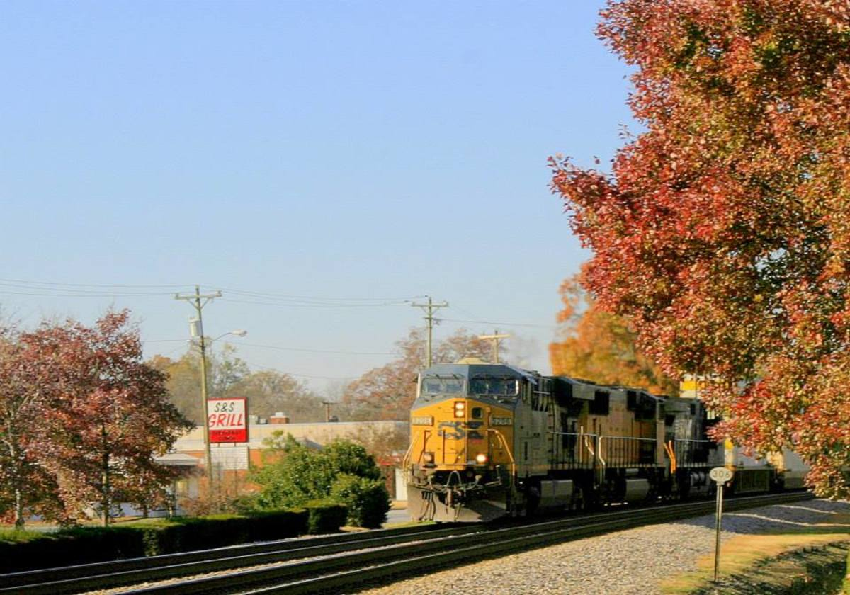 A freight train leaves a major hub