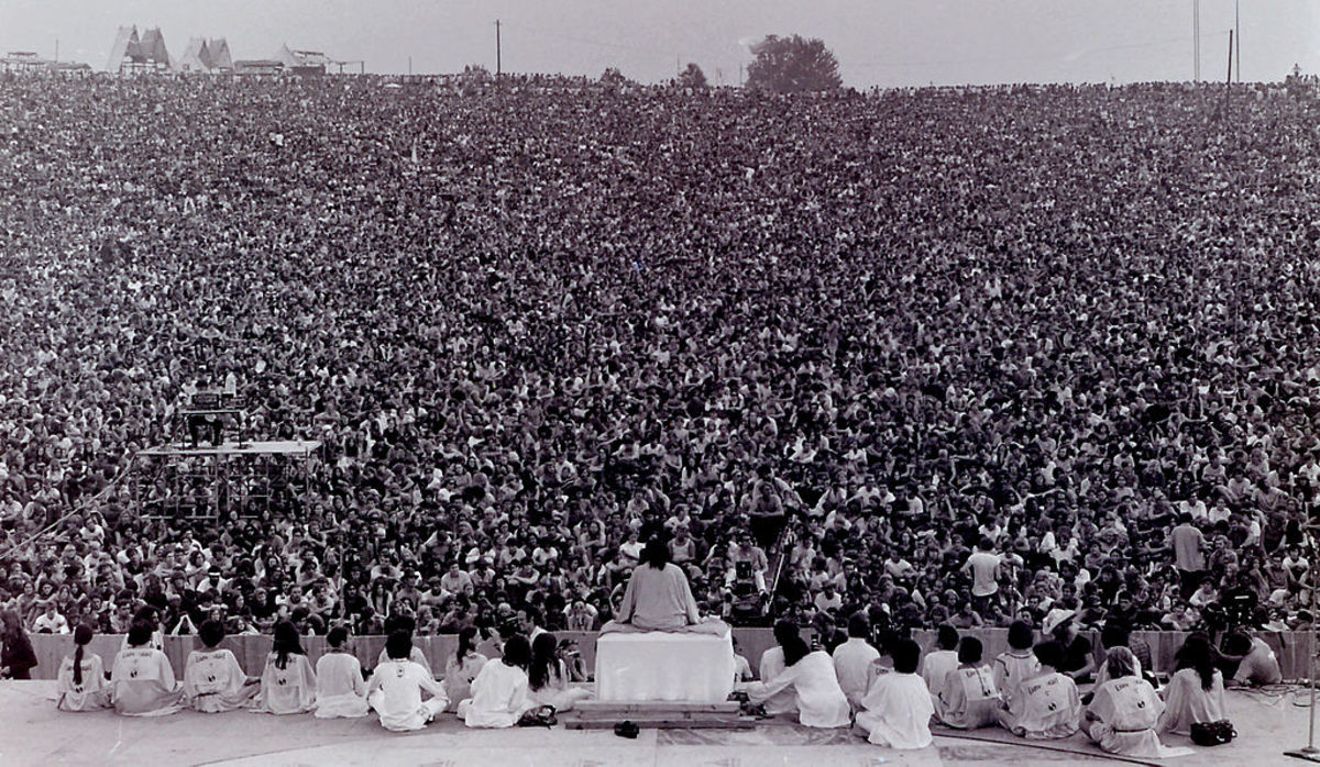 Opening ceremony at Woodstock. Swami Satchidananda speaking.