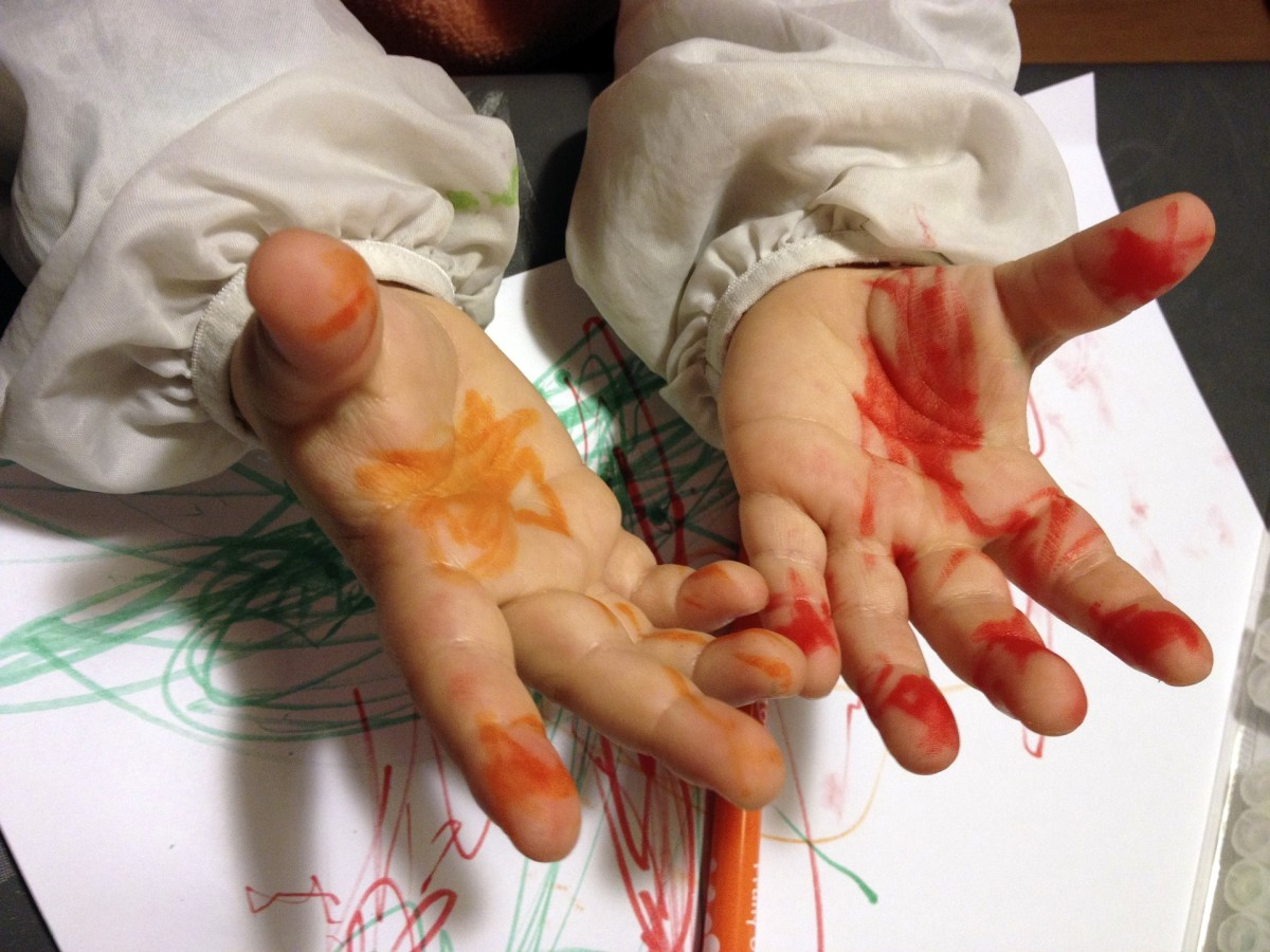 Paint stained little Gita's hands.