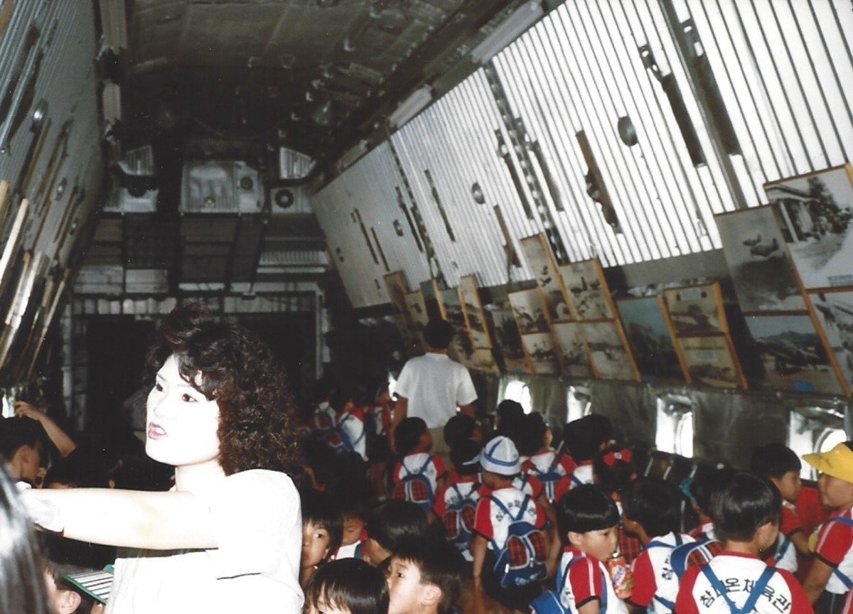 School children and their teacher inside the cargo bay of the C-124.