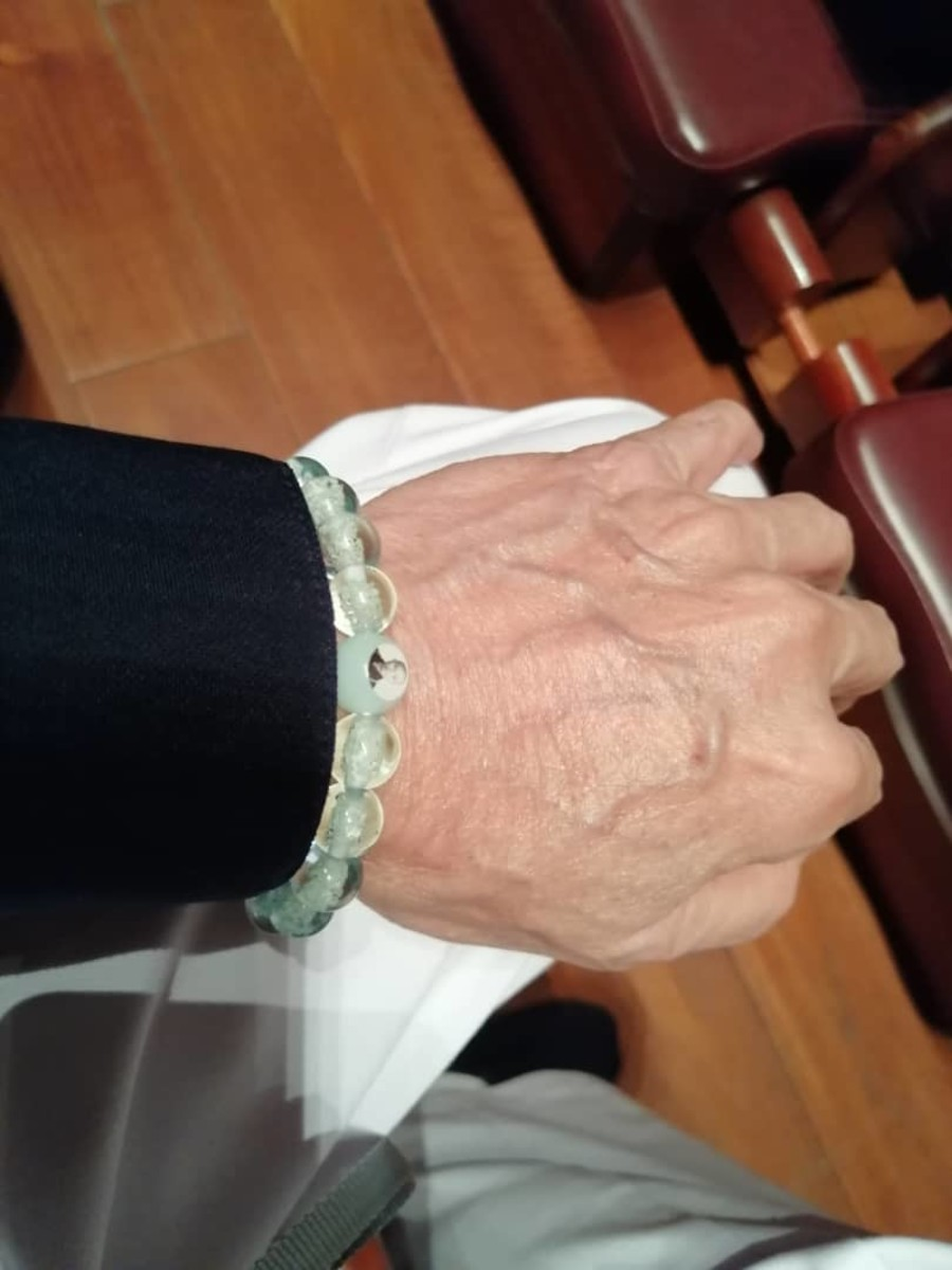 The glowing-beads bracelet, with Master's image, a spiritual gift from the Master.