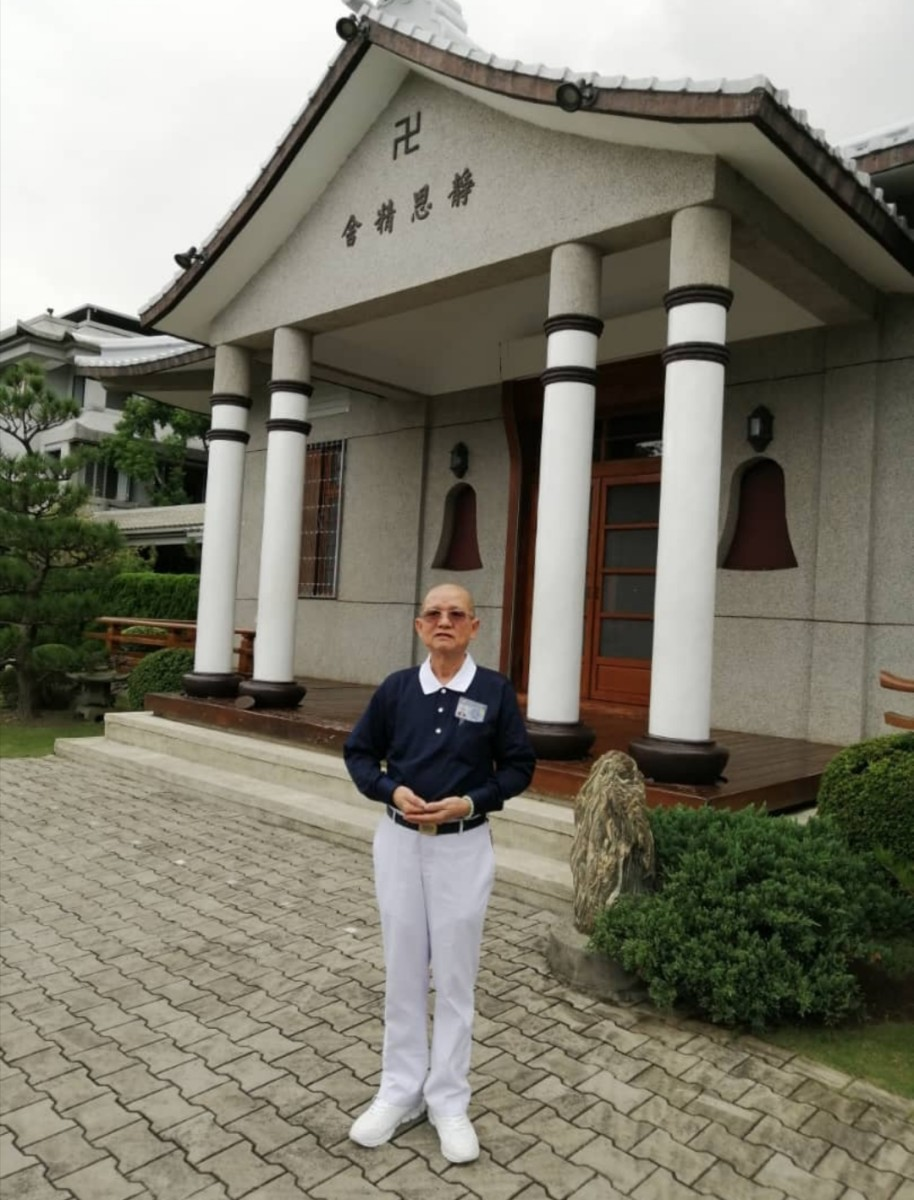 Good Guy in front of the Master's abode, Hualien, Taiwan.