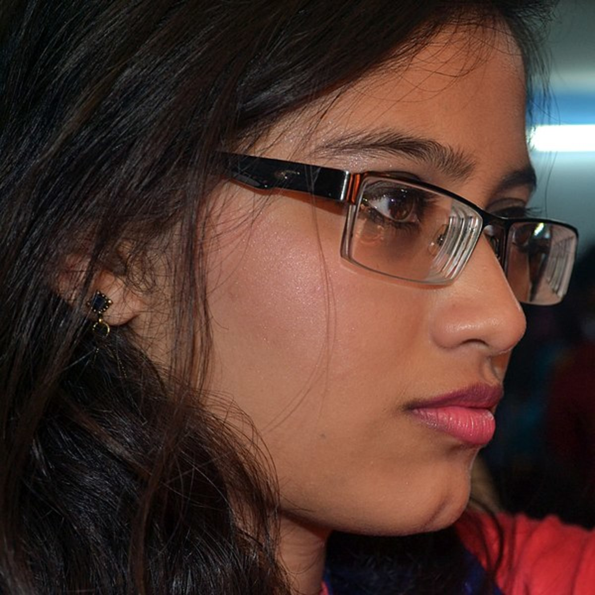 Bangladeshi woman wearing glasses--this Non-Working Eyeglasses thing is now going global.
