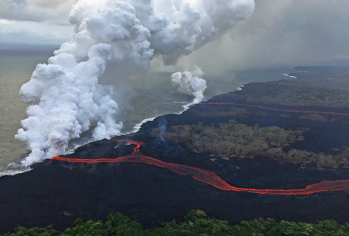 Lava enters the ocean creating plumes of laze along Puna coastline. (Photo courtesy of USGS-HVO)