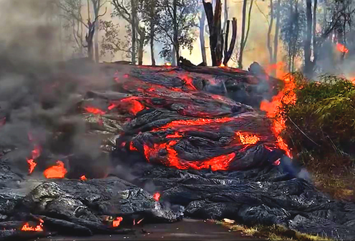 A wall of lava comes down a residential street. (Photo courtesy of USGS-HVO)