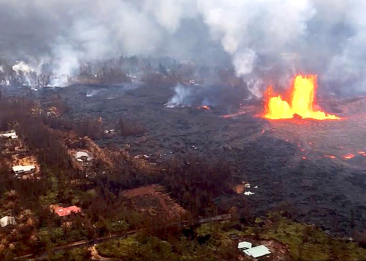 Lava from an erupting fissure covers the neighborhood of Leilani Estates. (Photo courtesy of USGS-HVO)