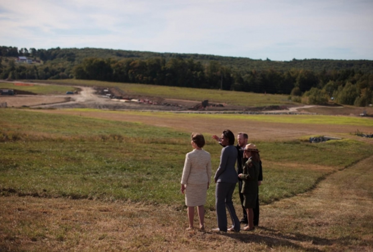 Former First Ladies Michelle Obama and Laura Bush survey the site of the Flight 93 airplane crash in Stonycreek Township, Pennsylvania, September 11, 2010.