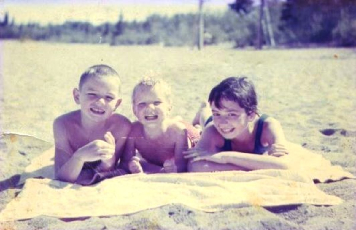 My little brothers and I the next summer, 1962, looking like 'normal happy kids'. SunnysideBeach, Emma Lake Saskatchewan