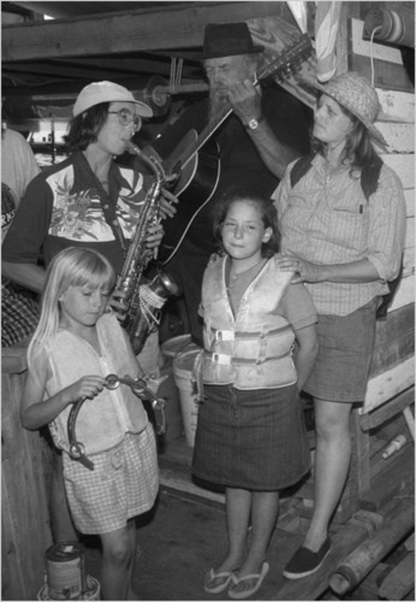Betsy Terrell playing saxophone with family