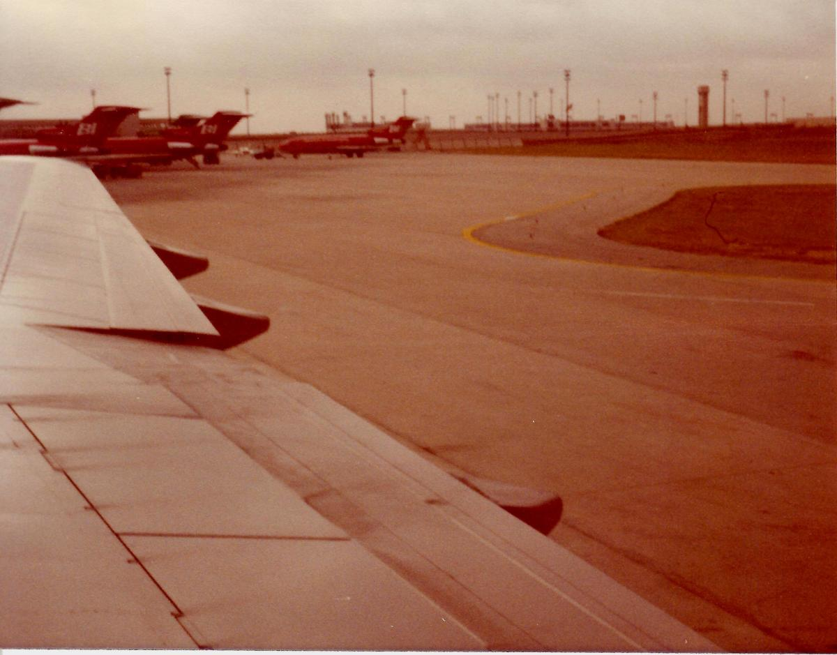 Braniff jets at the gates ready for boarding.