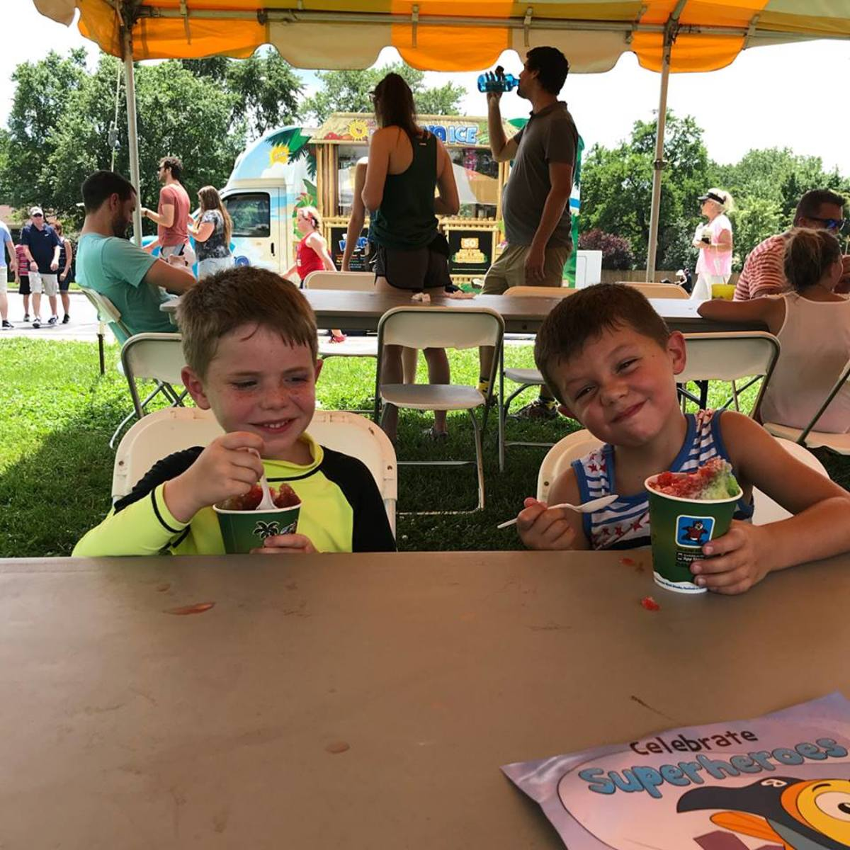 Two 6-year old's enjoying a time honored tradition of Sno-Cones
