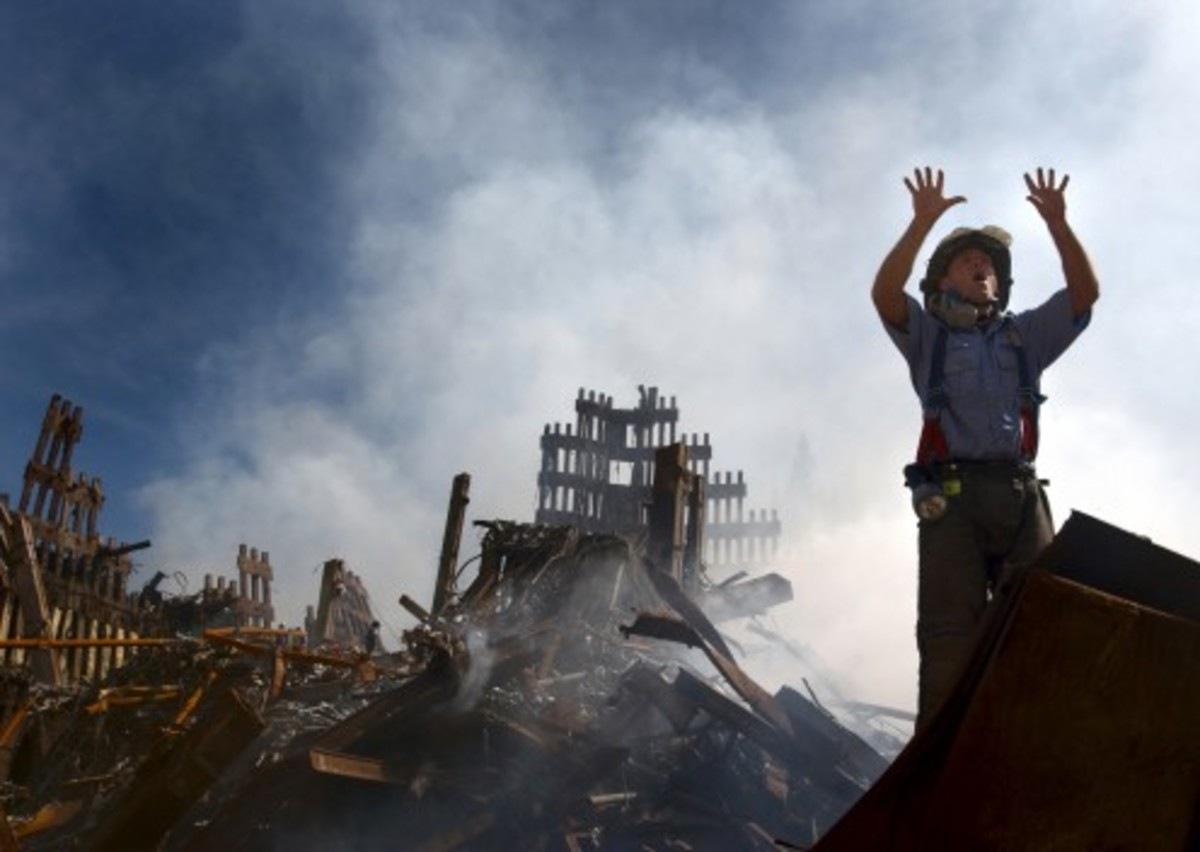 A New York City fireman calls for 10 more rescue workers to make their way into the rubble of the World Trade Center