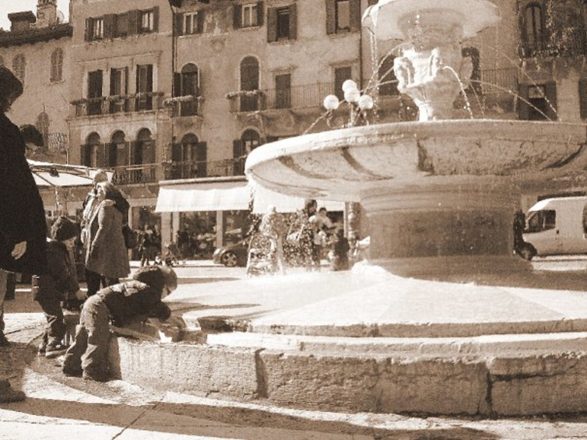 My shot of a child playing in a fountain in Verona, Italy.