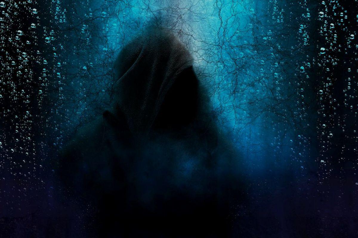 Hooded figure