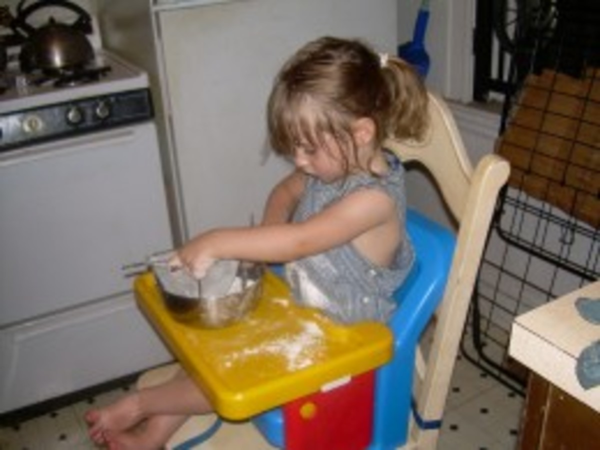 "Young ""Flour Child"" at work in the kitchen"