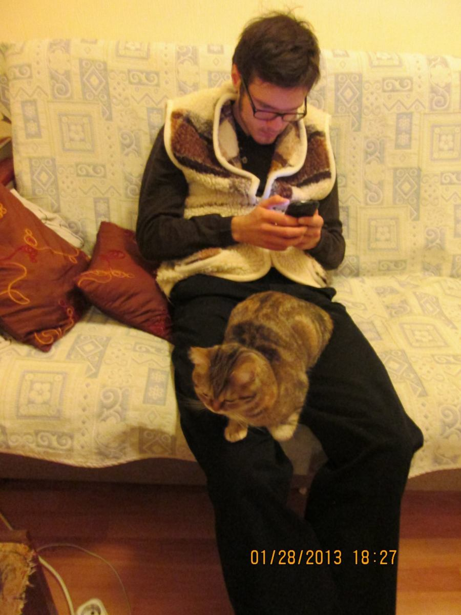 Me with a feline friend at the apartment of my ex girlfriend's grandmother in the Ukraine