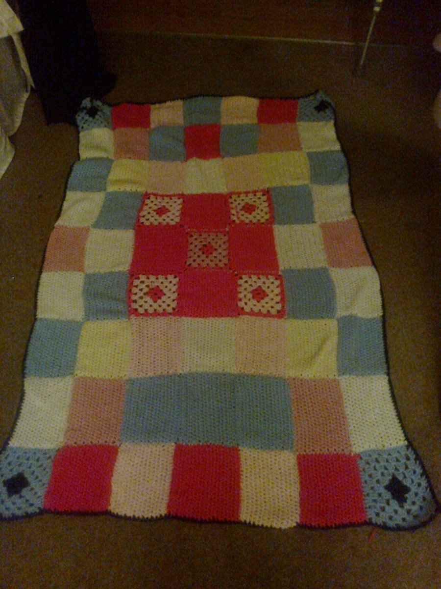 Get creative. This blanket is so easy. Crochet small individual squares and sew together.