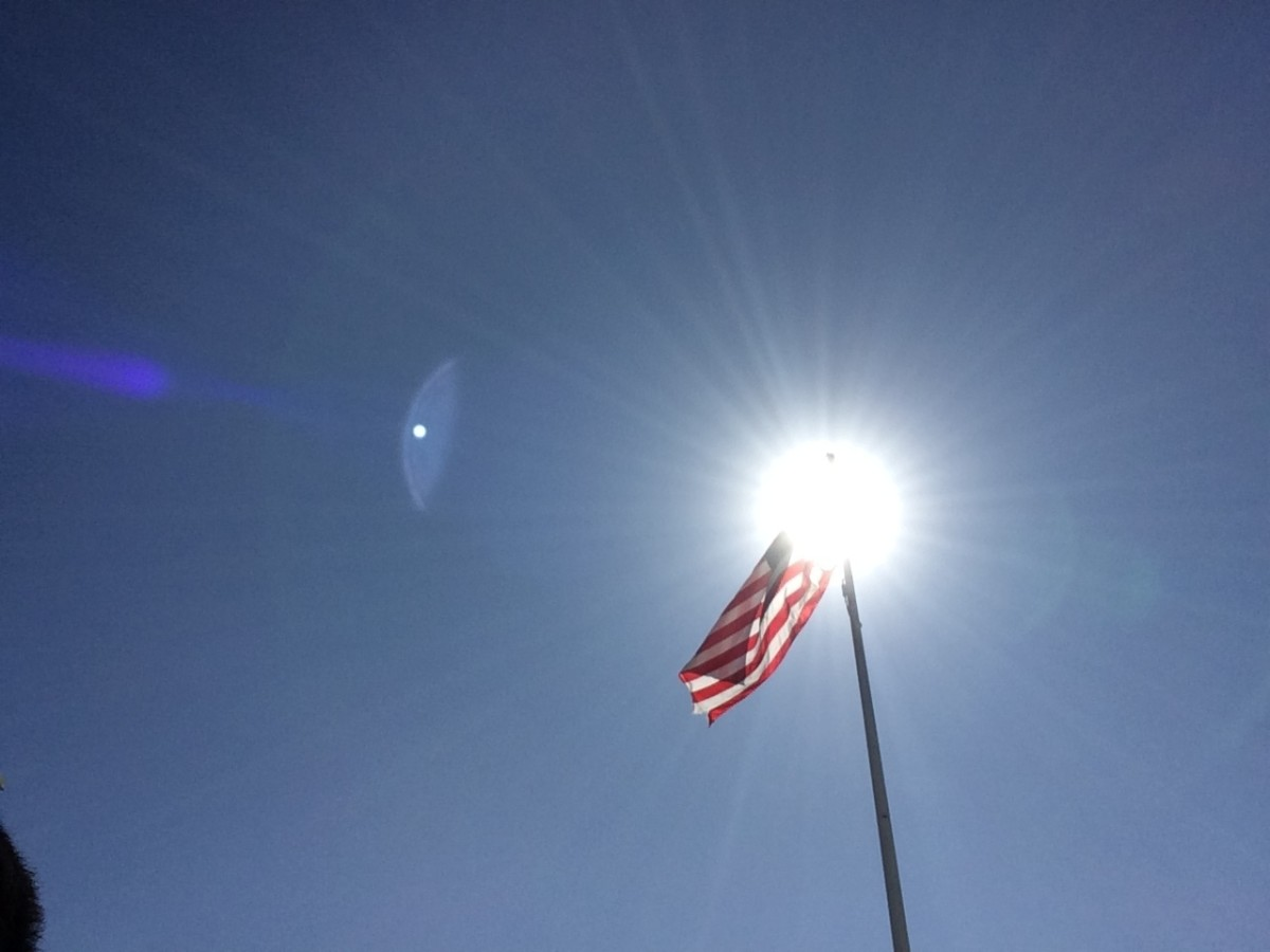 Taken by Kevin C. Davison at Seaside, Oregon Coast. American Flag Illuminated by the Sun.