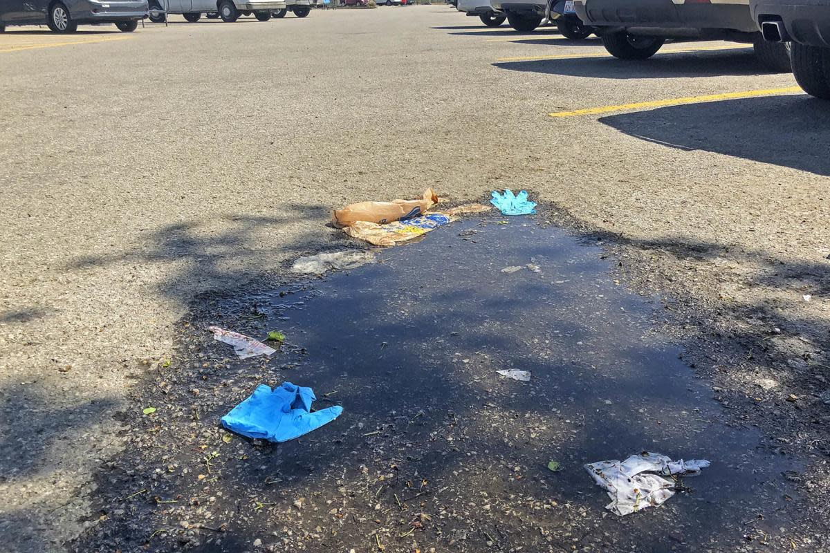 Some people like to decorate parking lots with used gloves