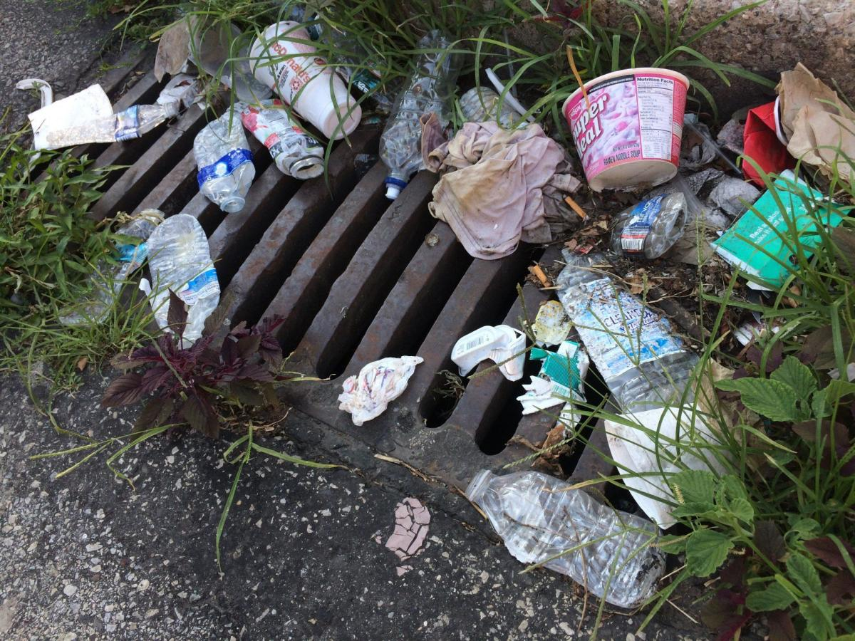 Discarded items threaten a storm drain