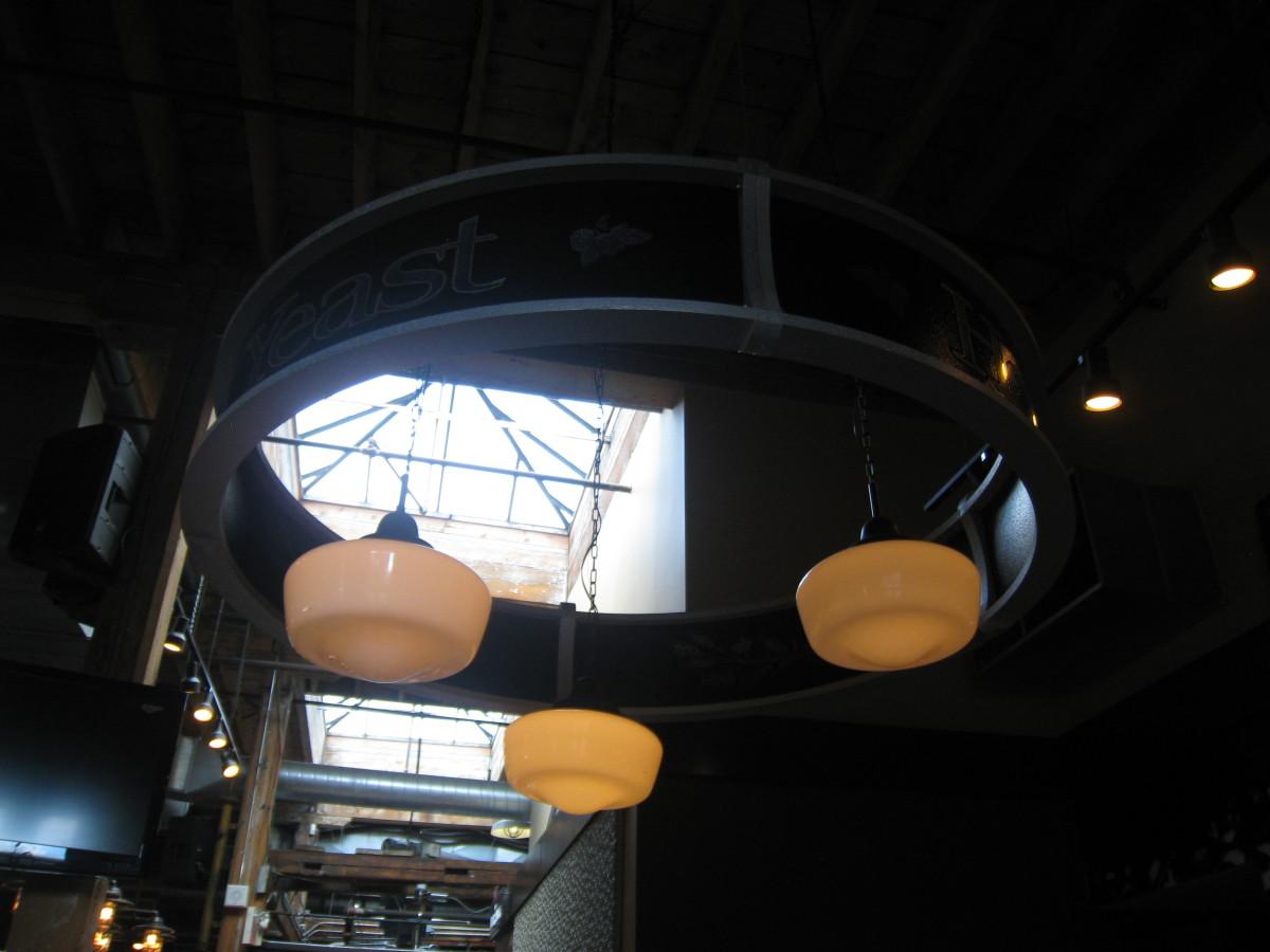 Few of the dim lights inside Mill Street Brew Pub restaurant.