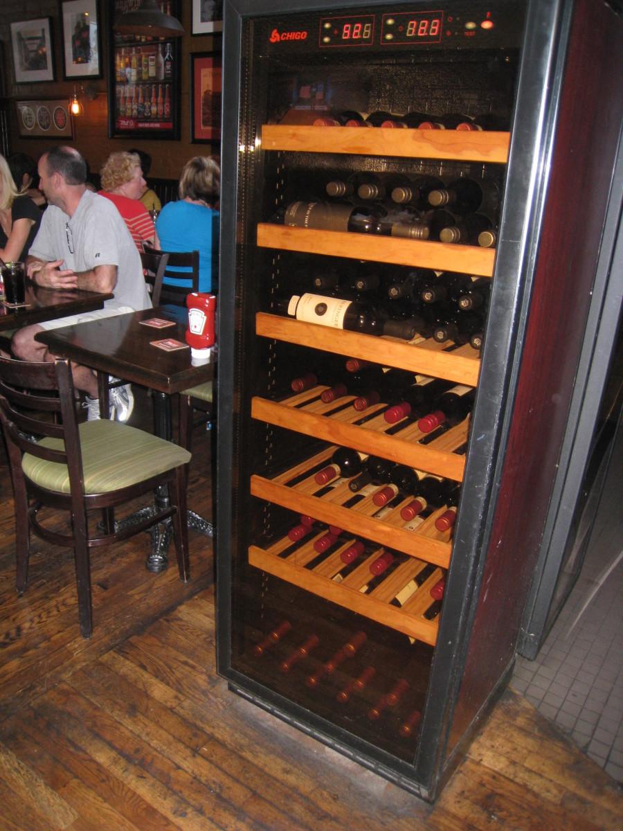 Wine cabinet beside the bar of Mill Street Brew Pub.
