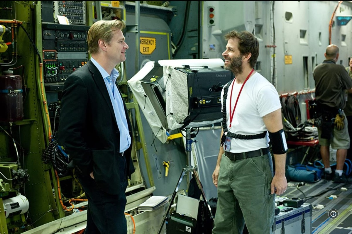 I couldn't find one including David S. Goyer, so imagine he's that piece of equipment standing behind Christopher Nolan and Zack Snyder.