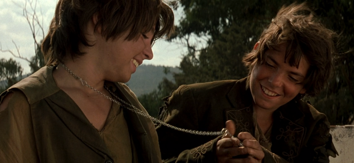 The Murrieta boys admire Zorro's medallion.