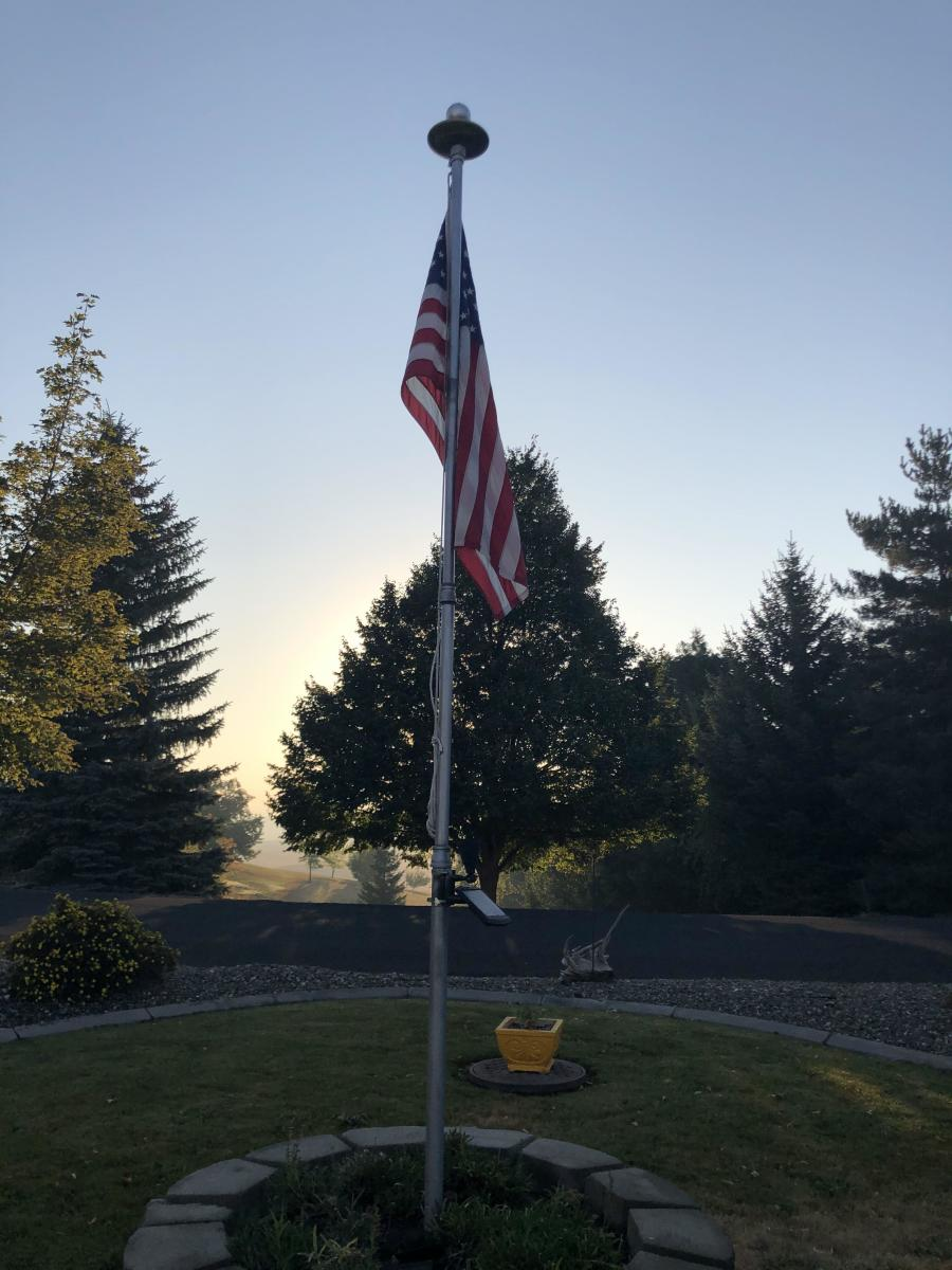 I took this picture of the flag and the flag pole in my front yard just after sunrise on the morning of 11 September 2020