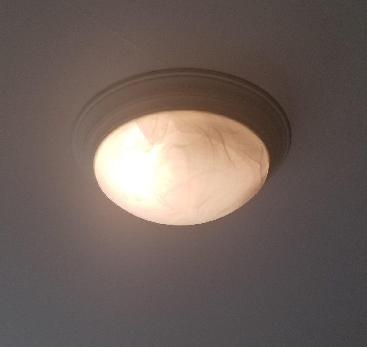 If your ceiling fixture does not provide a lot of light, buy a desk lamp.
