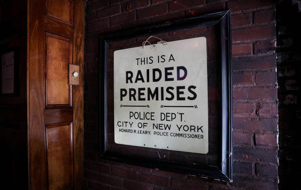 "This ""Raided Premises"" sign is displayed in the Stonewall Inn."